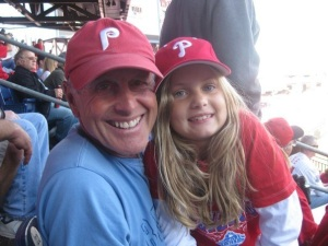 My dad with my youngest child, Sammie at a baseball game. He died in 2010 of Mesothelioma.