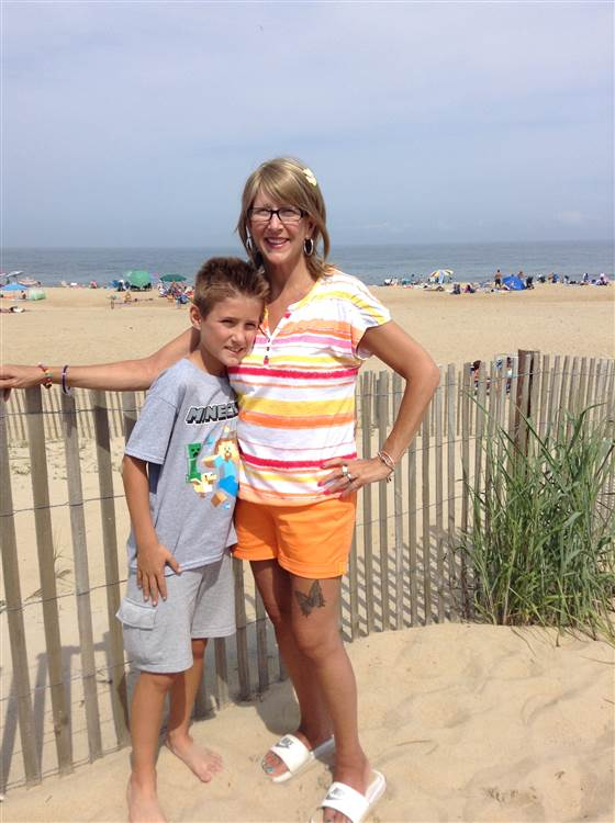 Wesley and his mom, Tricia Somers, share a happy moment on the beach.