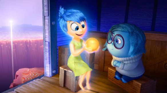 Joy (left, voiced by Amy Poehler) and Sadness (voiced by Phyllis Smith) catch a ride on the Train of Thought in Pixar's Inside Out. The movie opens in theaters nationwide June 19. Disney/Pixar